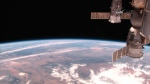 This image made from video provided by NASA shows part of the International Space Station with the Earth in the background on  Feb. 25, 2015. (NASA / AP Photo)