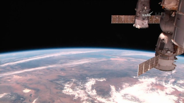 Astronauts start spacewalk series to fix cosmic ray detector