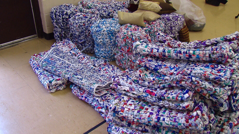 A volunteer initiative launched in Toronto following the 2010 Haitian earthquake has helped countless of people in need -- including those in disaster zones -- by providing mats made of recycled milk bags.