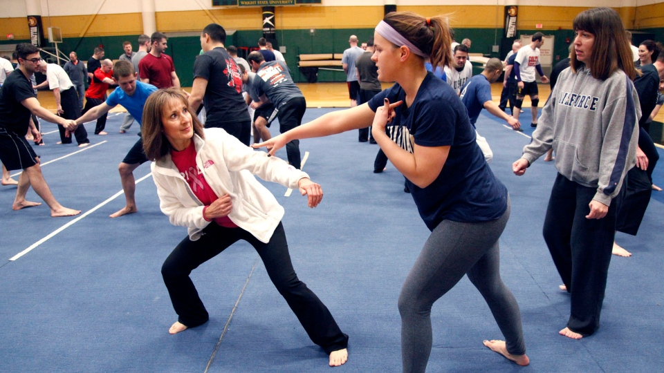 FILE - Women work on self-defence techniques during a week long training program in Dayton, Ohio, on March 10, 2014 (AP Photo/The Dayton Daily News, Lisa Powell)