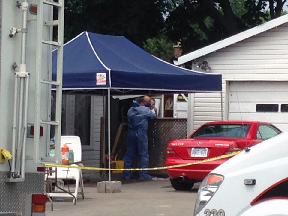 Police investigate outside the home of Stephan and Seble Dietrich on Wednesday, June 10, 2015. (Nicole Lampa / CTV Kitchener)