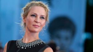 Actress Uma Thurman poses for photographers as she arrives for the screening of Nymphomaniac: Volume I at the 71st edition of the Venice Film Festival in Venice, Italy, Monday, Sept. 1, 2014. (AP / Andrew Medichini)