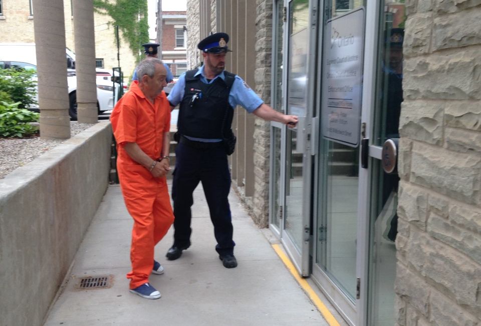 Frank Fischer, who is charged with murder in the death of his wife, is led into court in Guelph on Friday, June 12, 2015. (Nicole Lampa / CTV Kitchener)