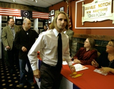 First voter, Tanner Tillotson, front centre, of Dixville Notch cast his ballot at the nation's presidential election in Dixville Notch, N.H. Tuesday Nov. 4, 2008. (AP / Cheryl Senter)