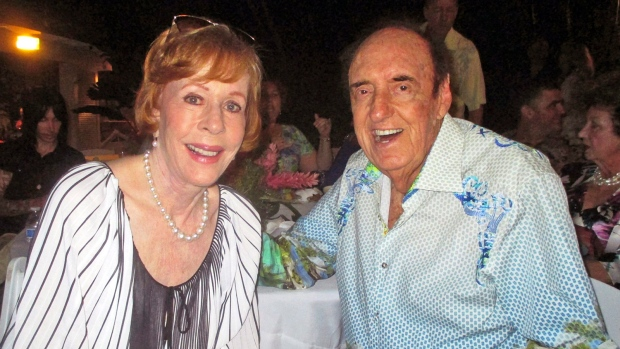 In this Friday, June 12, 2015 photo, Jim Nabors and his friend and longtime collaborator in comedy Carol Burnett celebrate Nabors' 85th birthday with nearly 300 people at his home in Honolulu. (John Berger/Honolulu Star-Advertiser via AP)