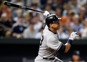 New York Yankees' Alex Rodriguez follows through on a two-run home run against the Baltimore Orioles during the sixth inning of a baseball game on June 13, 2015, in Baltimore. (Gail Burton / AP Photo)