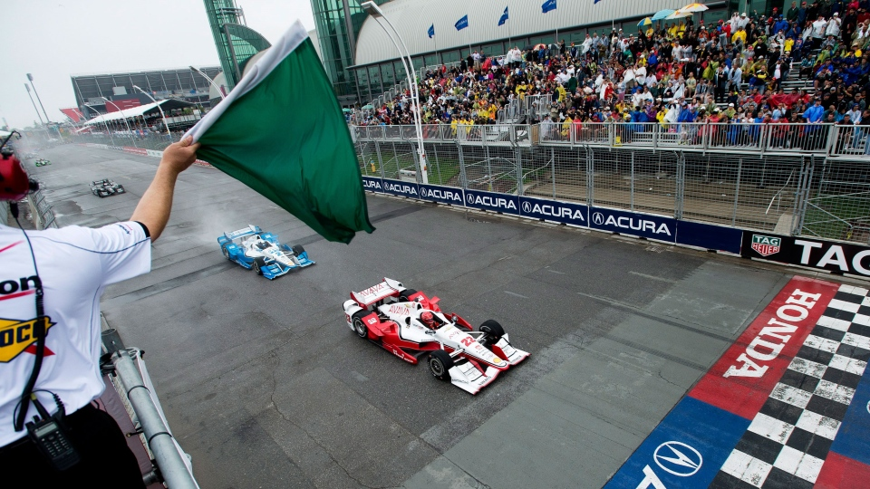 Simon Pagenaud leads Juan Pablo Montoya as they race past the start line during the Honda Toronto Indy in Toronto on Sunday, June 14, 2015. (Nathan Denette / THE CANADIAN PRESS)