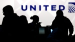 In this file photo, holiday travelers check in at the United Airlines ticket counter at Terminal 1 in O'Hare International Airport in Chicago on Saturday, Dec. 21, 2013. (AP / Nam Y. Huh)