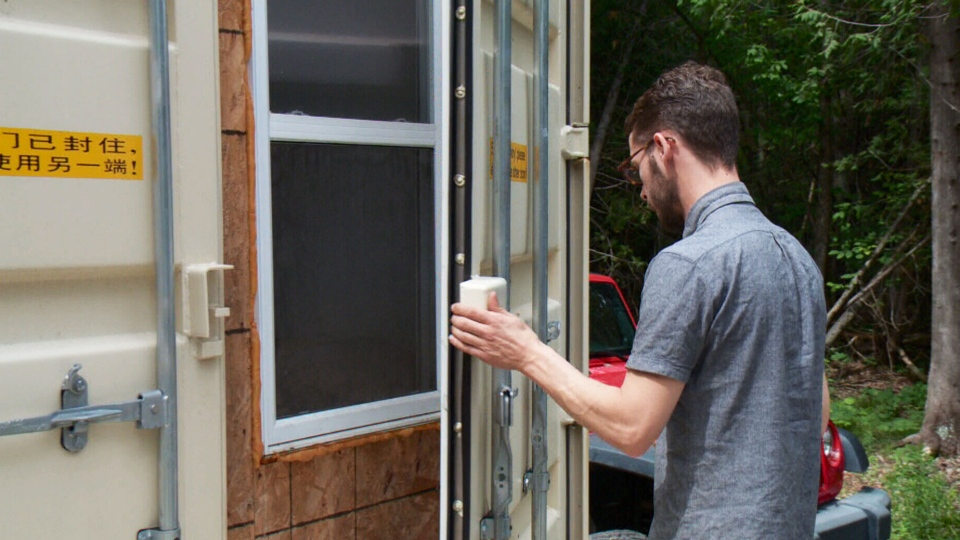 Former engineering student Joseph Dupuis has constructed a 355-square-foot secluded cabin outside Ottawa out of three shipping containers.