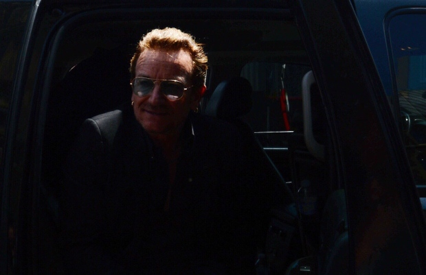 U2 frontman Bono steps out of a limousine in Ottawa on Monday, June 15, 2015. Bono is in Ottawa for a meeting with political leaders and non-profit organizations. (Sean Kilpatrick/THE CANADIAN PRESS)
