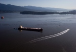 Crews on spill response boats work around the bulk carrier cargo ship Marathassa after a bunker fuel spill on Burrard Inlet in Vancouver, B.C., on April 9, 2015. (Darryl Dyck / THE CANADIAN PRESS)