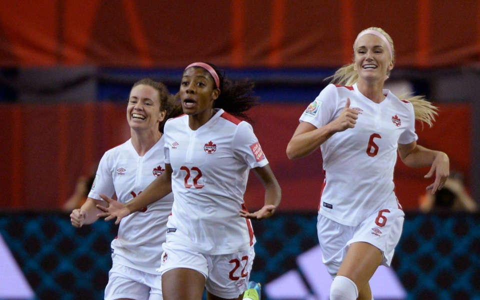 Canada's Ashley Lawrence reacts after scoring against Netherlands during first half FIFA Women's World Cup game in Montreal on Monday, June 15, 2015. (Paul Chiasson / THE CANADIAN PRESS)