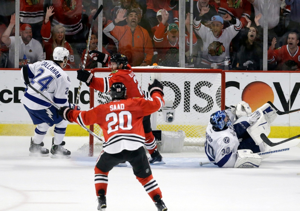 Chicago Blackhawks' Duncan Keith celebrates with teammate Brandon Saad (20) after scoring past Tampa Bay Lightning goalie Ben Bishop (30) and Ryan Callahan (24) during the second period in Game 6 of the NHL hockey Stanley Cup Final on June 15, 2015. (AP / Charles Rex Arbogast)