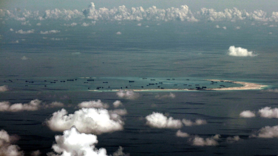This aerial photo taken through a glass window of a military plane shows China's alleged on-going reclamation of Mischief Reef in the Spratly Islands in the South China Sea on Monday, May 11, 2015. (AP / Ritchie B. Tongo)