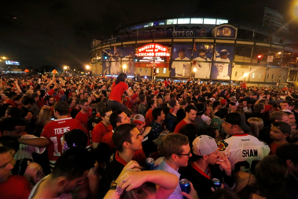 Chicago Blackhawks fans gather near Wrigley Field after the Blackhawks won the Stanley Cup, defeating the Tampa Bay Lightning in Chicago on Monday, June 15, 2015. (AP / Christian K. Lee)