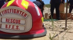A Barrie Fire and Emergency Services' firefighter helmet can be seen in Barrie, Ont. on June 3, 2015. (KC Colby/ CTV Barrie)