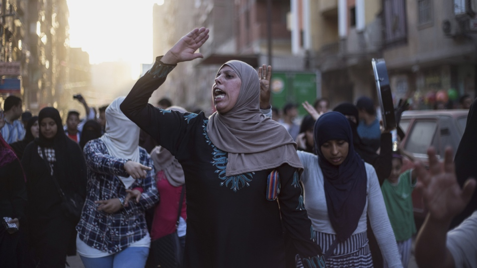 Supporters of the Muslim Brotherhood chant slogans against the Egyptian court ruling of the death sentence for ousted Islamist President Mohammed Morsi over a mass prison break during the country's 2011 uprising, while holding a protest in Cairo, Egypt, Tuesday, June 16, 2015. (AP / Belal Darder)