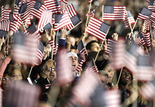 Supporters cheer as they watch the television networks project results that Barack Obama has been elected president of the United States at Grant Park in Chicago, Tuesday night, Nov. 4, 2008. (AP / M. Spencer Green)