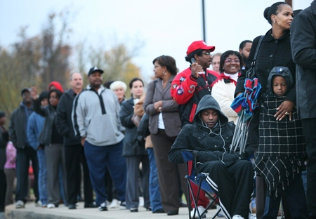 Dee Reed and her six year-old son Kevon wait patiently outside of Olive B. Loss Elementary school as they wait for the polling place to open on election day in Bear, Del. on Tuesday, Nov. 4, 2008. (AP / The News Journal, Ron Soliman)