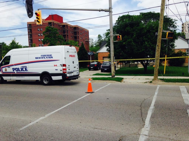 Police continue to investigate at a Commissioners Road home after an assault turned fatal in London, Ont. on Wednesday, June 17, 2015. (Gerry Dewan / CTV London)