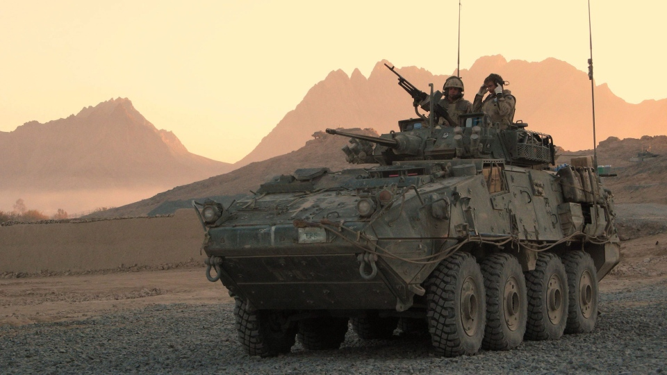 A Canadian LAV (light armoured vehicle) arrives to escort a convoy at a forward operating base near Panjwaii, Afghanistan at sunrise in this Nov. 26, 2006 file photo. (Bill Graveland / THE CANADIAN PRESS)