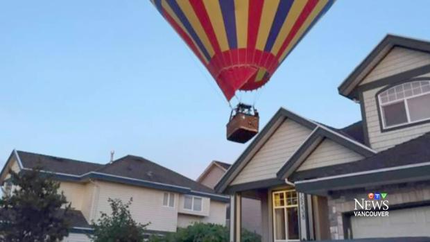 A hot air balloon flies over a neighbourhood in Cloverdale, B.C., Wednesday, June 17, 2015.