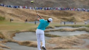 Rory McIlroy, of Northern Ireland, watches his tee shot on the fourth hole during the first round of the U.S. Open golf tournament at Chambers Bay on Thursday, June 18, 2015 in University Place, Wash. (AP / Matt York)
