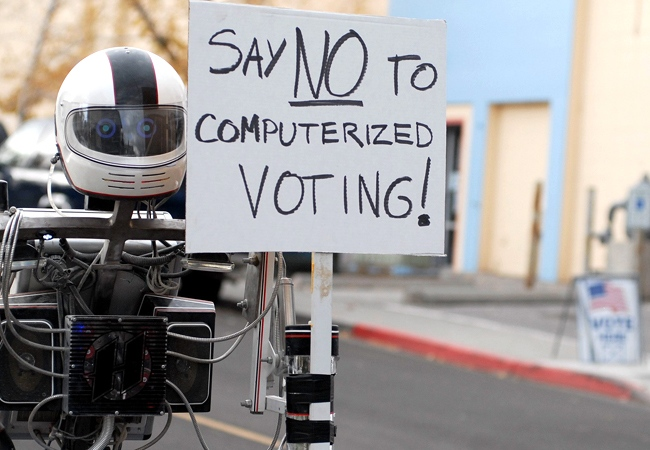 A robot named Hotshot protests electronic voting near a voting station in Reno, Nevada, Tuesday, Nov. 4, 2008. (Nevada Appeal / Kevin Clifford)