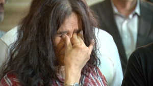 A 60s Scoop survivor cries at the Manitoba Legislature on June 18, 2015.