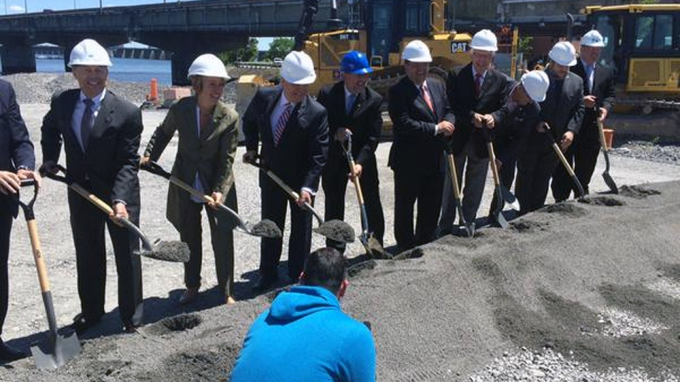 Politicians and others celebrate a groundbreaking ceremony for the new Champlain Bridge on Friday June 19, 2015 (CTV Montreal/Natalie Nanowski)