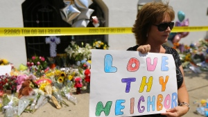 Sherry Ramsey, of Mount Holly, N.C., holds a message after traveling to the Emanuel African Methodist Episcopal Church, in Charleston, S.C., on Friday, June 19, 2015. (Curtis Compton / Atlanta Journal-Constitution via AP)