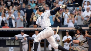 New York Yankees' Alex Rodriguez follows through on a home run during the first inning of a baseball game against the Detroit Tigers on Friday, June 19, 2015, at Yankee Stadium in New York. The home run was his 3,000th career hit. (AP / Bill Kostroun)