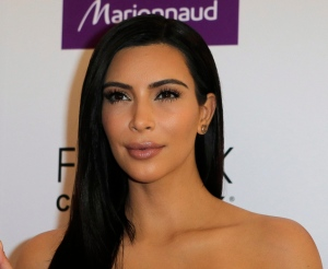 In this April 15, 2015, file photo, Kim Kardashian attends a photocall to launch hair products in Paris. (AP / Jacques Brinon)