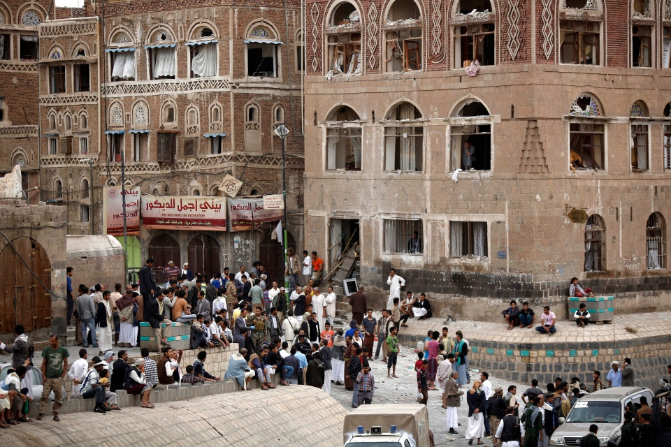 People gather at the site of an explosion near the old city of Sanaa, Yemen, Saturday, June 20, 2015. (AP / Hani Mohammed)