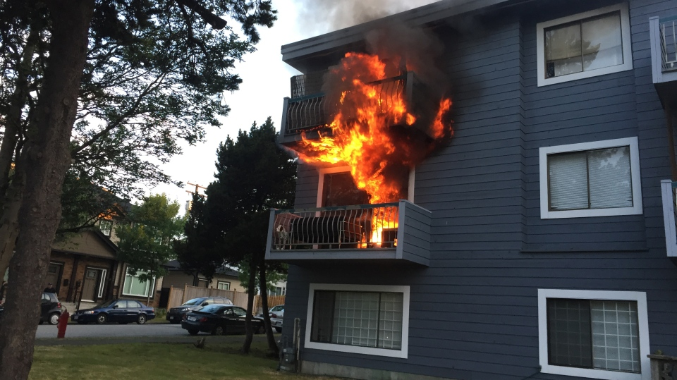 Flames pour from the second floor apartment to the balcony above (Submitted).