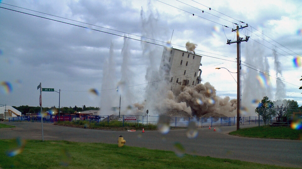 The Parrish and Heimbecker mill is demolished in Saskatoon early Saturday morning.