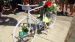 "This photo shows the ""ghost bike"" chained to a pole in memory of Adam Excell, a cyclist hit and killed on June 13."