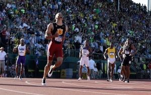 Andre De Grasse, front, continues around the track ahead of competitors after winning the 200-meter dash during the NCAA track and field championships in Eugene, Ore., on Friday, June 12, 2015. (AP / Don Ryan)