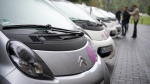 Citroen electric cars are filmed by a TV crew during the launch of a car sharing scheme in Berlin. (AFP / Odd Andersen)