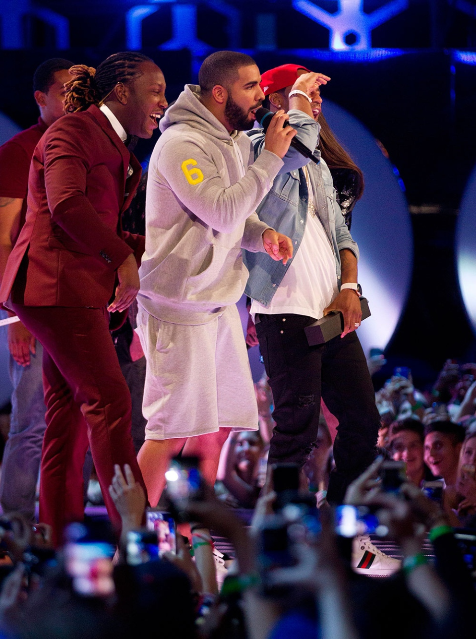 Drake, centre, makes an appearance on stage during the 2015 Much Music Video Awards in Toronto on Sunday, June 21, 2015. THE CANADIAN PRESS/Chris Young