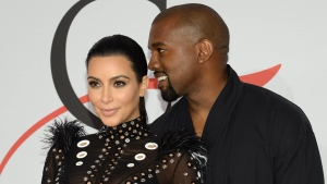 Kim Kardashian, left, and Kanye West arrive at the 2015 CFDA Fashion Awards at Alice Tully Hall, Lincoln Center, on June 1, 2015, in New York. (Evan Agostini / Invision)