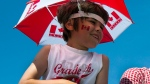 An unidentified youth watches a Canada Day parade in Halifax on Sunday, July 1, 2012. (Andrew Vaughan / THE CANADIAN PRESS)