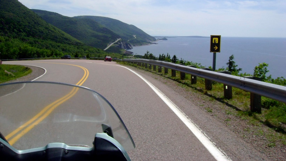 This July 13, 2010 photo shows the road along the eastern edge of Cape Breton Island during a 1,555-mile motorcycle tour along the Cabot Trail in Cape Breton, Nova Scotia. (AP / Glenn Adams)