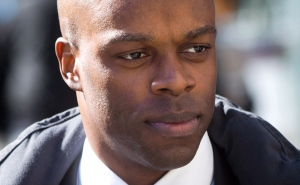 RCMP Const. Kwesi Millington leaves court during a lunch break at his perjury trial in Vancouver, B.C., on Monday March 10, 2014. THE CANADIAN PRESS/Darryl Dyck