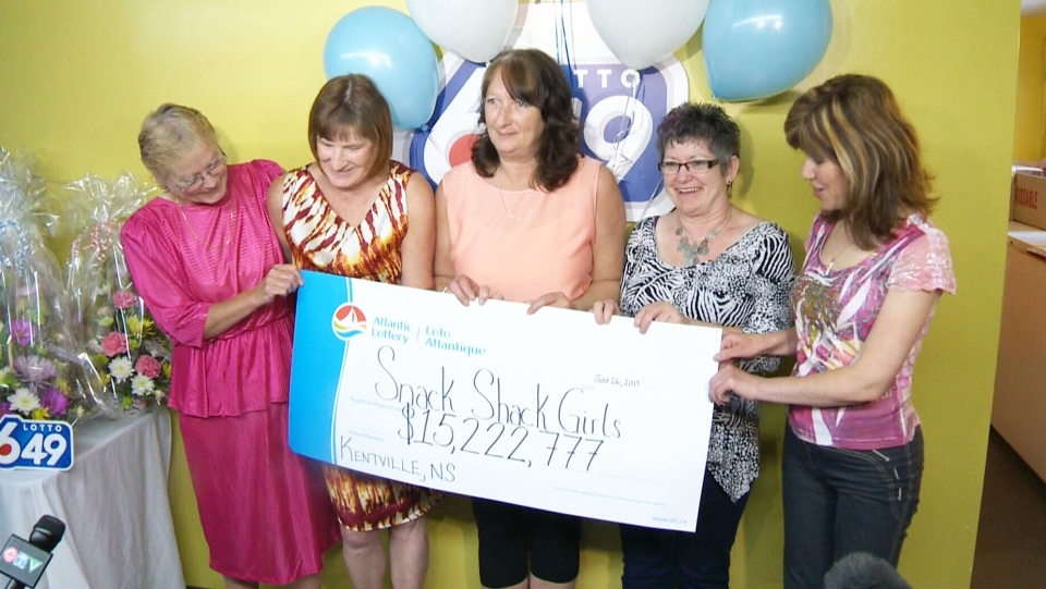 The 'Snack Shack' girls collect a cheque for over $15 million after winning the lottery in Nova Scotia.
