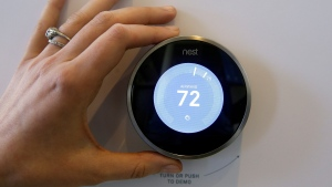 The Nest thermostat is on display following a news conference Wednesday, June 17, 2015, in San Francisco. (AP Photo/Eric Risberg)