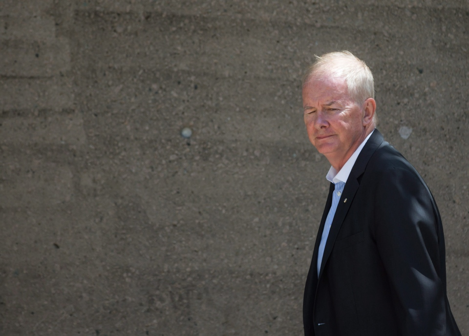 Former Vancouver Olympics CEO John Furlong arrives at B.C. Supreme Court after the lunch break during the second week of a defamation case brought against him by journalist Laura Robinson on Monday June 22, 2015. (Darryl Dyck / THE CANADIAN PRESS)