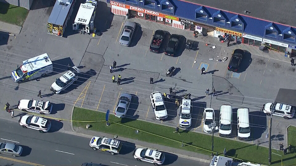 York Regional Police at the scene of the shooting on Islington Avenue in Vaughan, Ont., Wednesday, June 24, 2015.