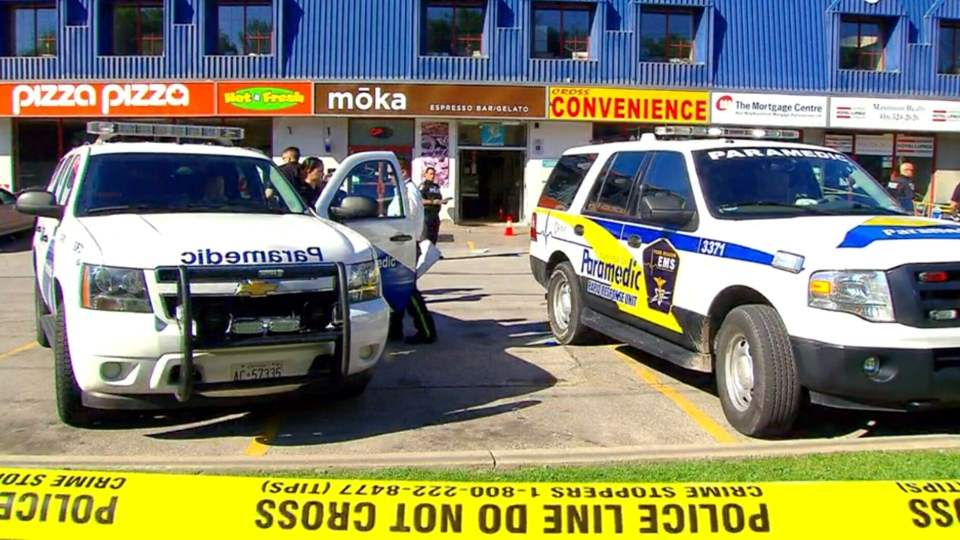 Police investigate a fatal shooting at Moka cafe in Vaughan, Ont., Wednesday, June 24, 2015.