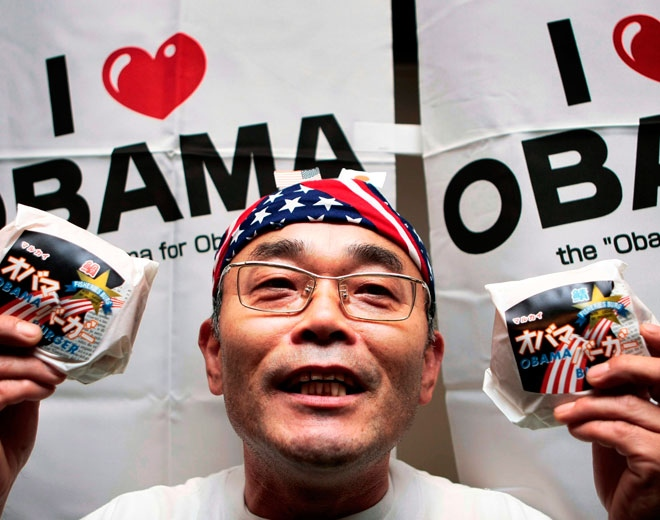 Koichi Morii, an Obama citizen, holds Obama fish burgers, which are sold in the city, to celebrate Barack Obama's victory in the U.S. presidential election in Obama, western Japan, Wednesday, Nov. 5, 2008. (AP / Itsuo Inouye)
